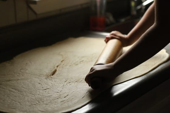 rolling out the dough for cinnamon rolls