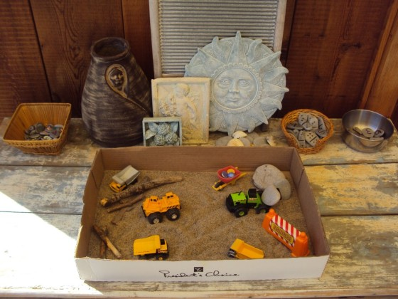 construction vehicle sensory bin in a cardboard box