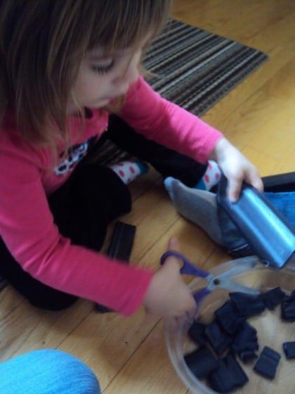 toddlers cutting styrofoam