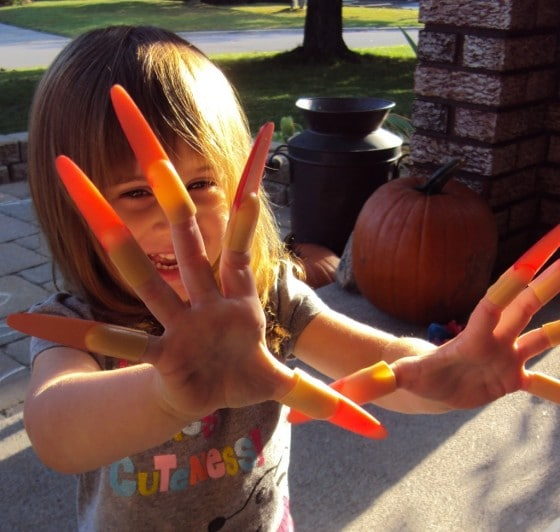 toddler with witch fingernails halloween sensory play