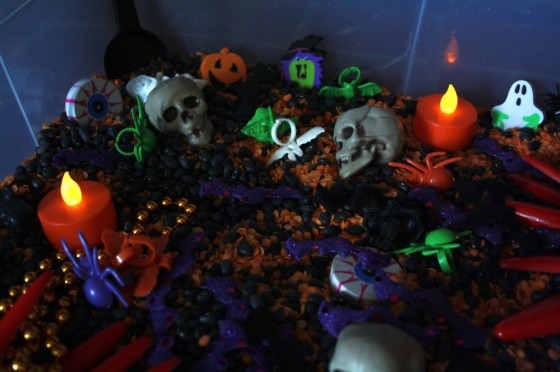 Halloween Sensory bin with battery tea lights