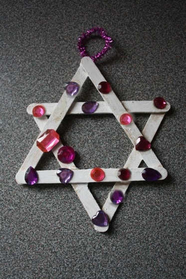 craft stick jewelled star ornament made by toddler