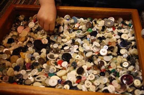 Child choosing buttons for Button Wreath craft