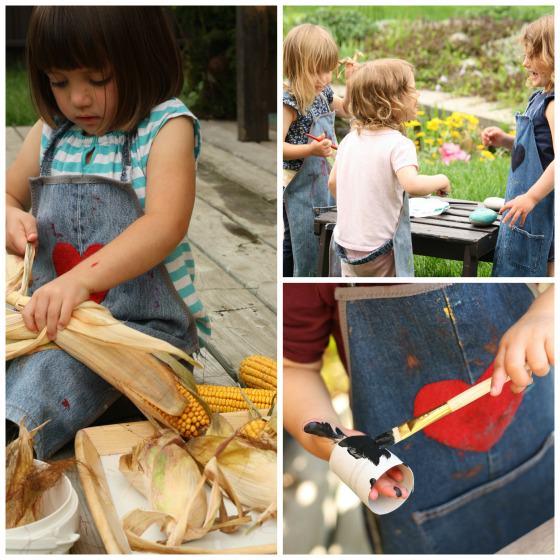 Denim kids' aprons on preschoolers crafting