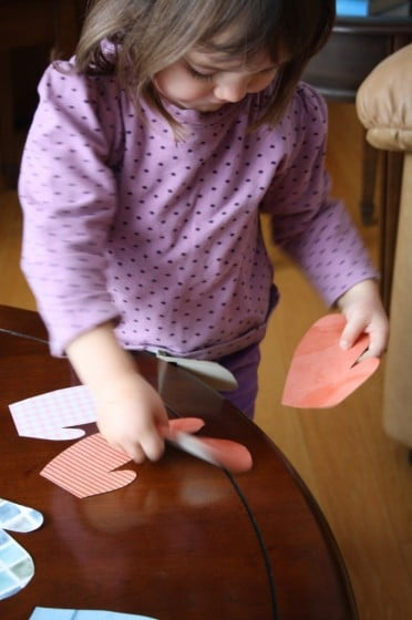 toddler matching up paper mitts