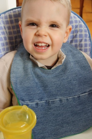 child wearing homemade denim bib