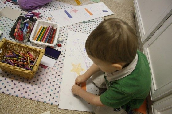 toddler stamping on paper