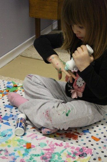 preschooler using ink dabbers