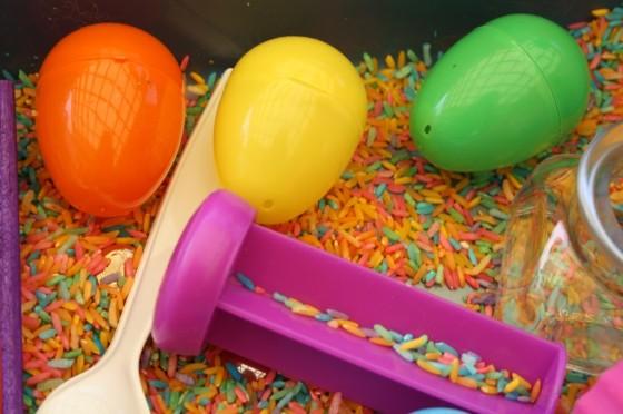 plastic eggs, spoon, dyed rice, jar