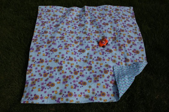 extra large, reversible receiving blanket with little people car on it