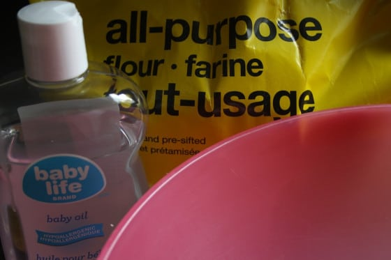 ingredients for cloud dough - flour and baby oil