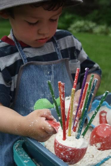 craft sticks in cloud dough
