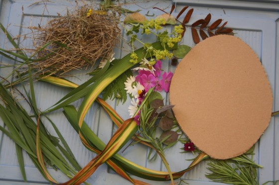 cardboard oval, long grasses, flowers