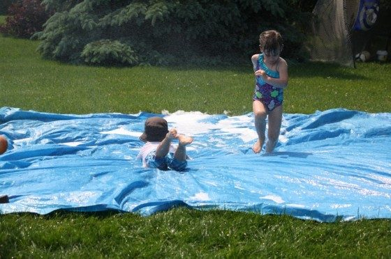 preschoolers on diy slip and slide