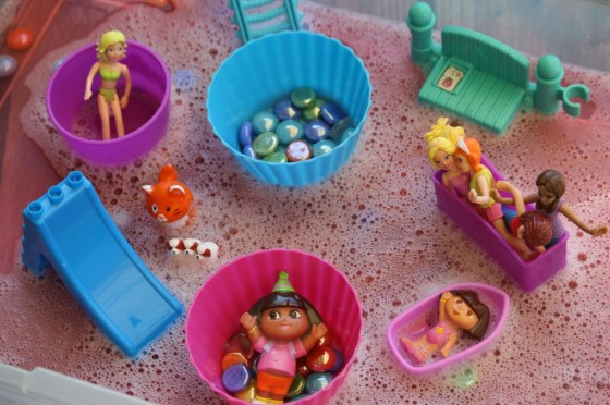 toys in soapy water activity bin