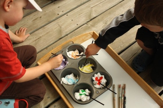 preschoolers colouring shaving cream with food colour