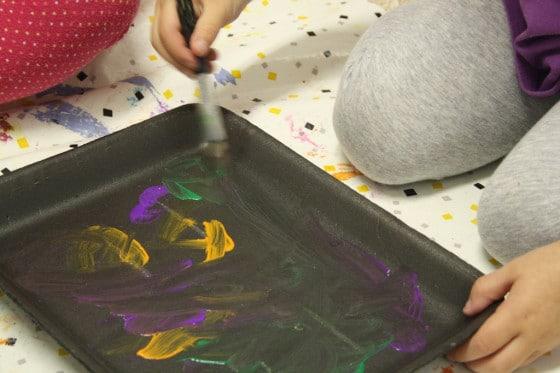 Kids painting styrofoam meat trays