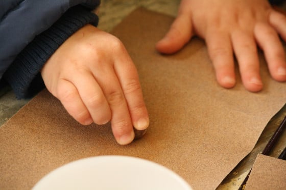 preschooler rubbing nutmeg on sandpaper