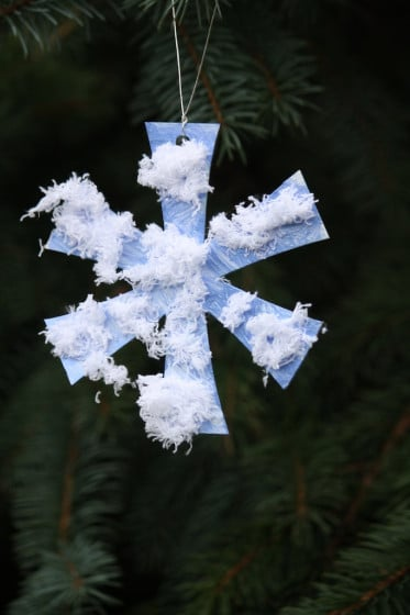 simple snowflake ornament hanging in tree