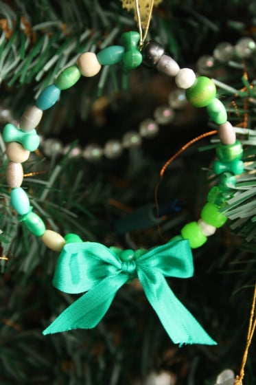 green bead wreath with green ribbon