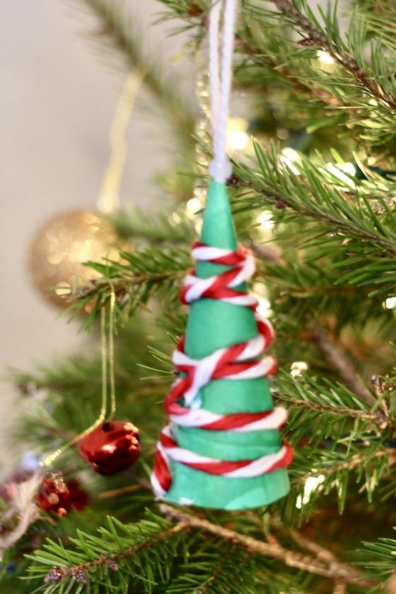 green paper cone tree on christmas tree