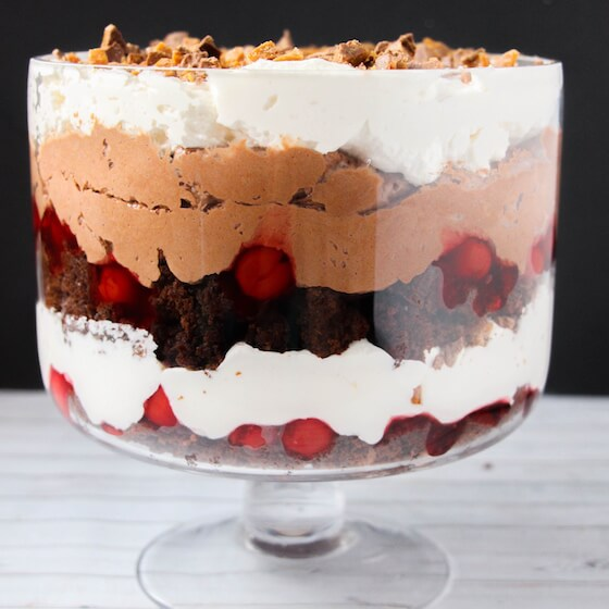 side view of trifle layered in glass trifle bowl