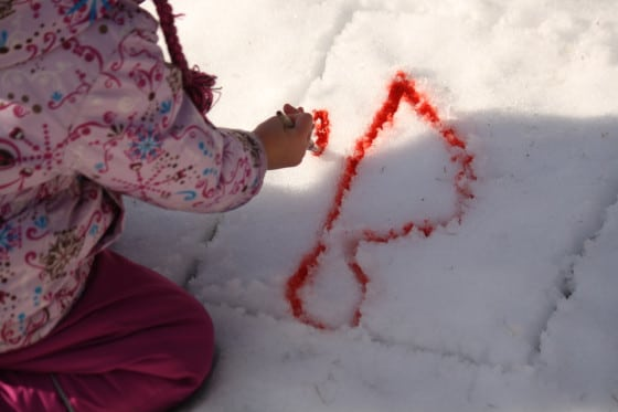 painting letters in the snow