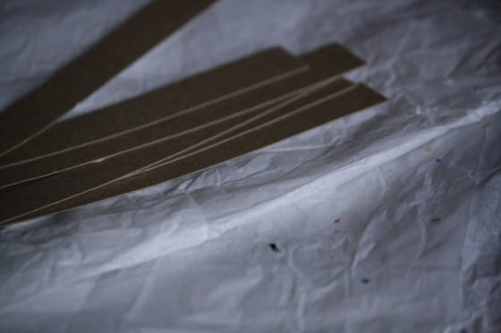 white tissue paper and strips of cardboard