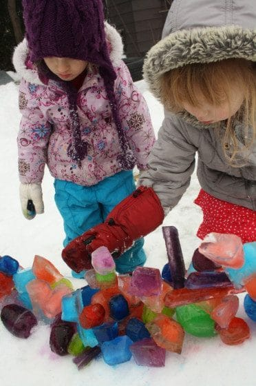 kids building coloured ice sculptures in the backyard