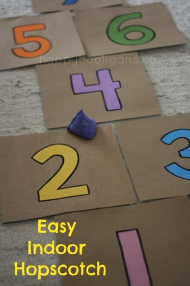 indoor hopscotch made with painted cardboard pieces and beanbag