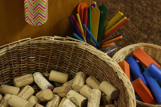 wine corks, craft sticks and blocks for cardboard drop zone