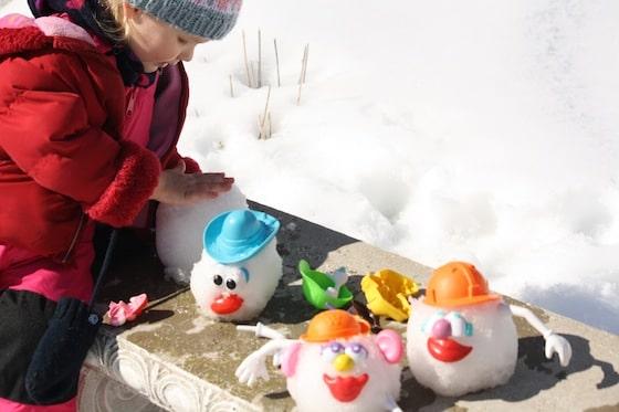 Unique snowman ideas: 3 potato heads in the snow