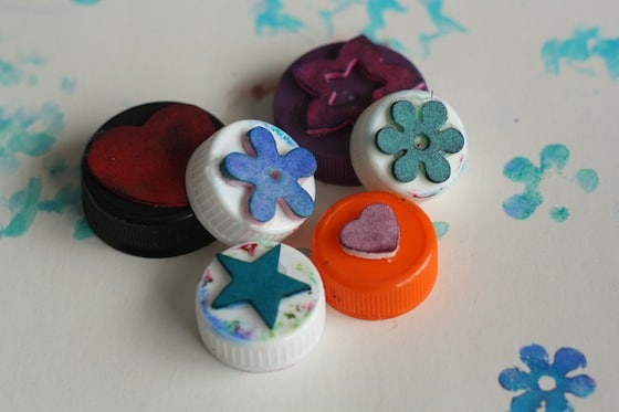 bottle tops with foam shapes glued on