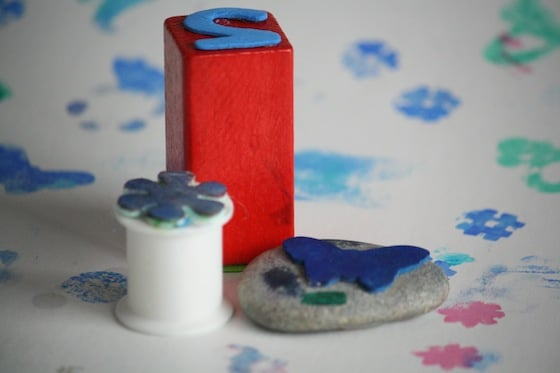 rock, spool and wooden block homemade stamps