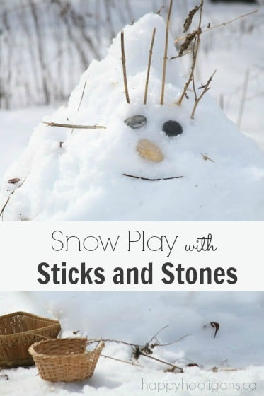 Playing with sticks and stones in the snow