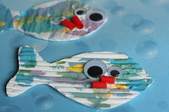 2 painted fish with googly eyes and mouths cut from pieces of a red straw