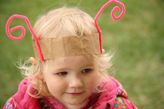 toddler wearing homeamde pink bug headband
