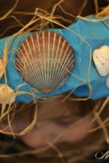 paper bag mermaid crown on girl's head
