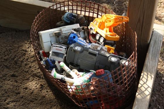organizing sandbox toys in basket