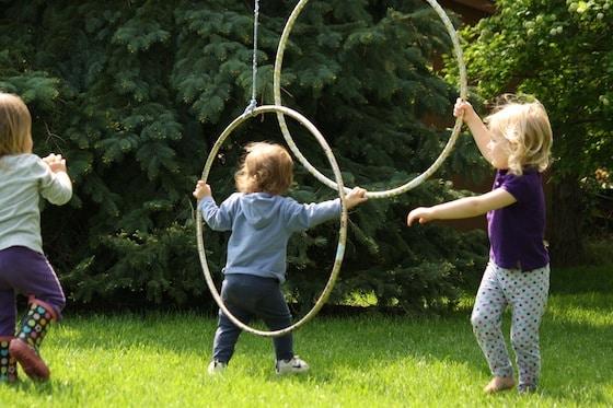 tossing balls through a hula hoop