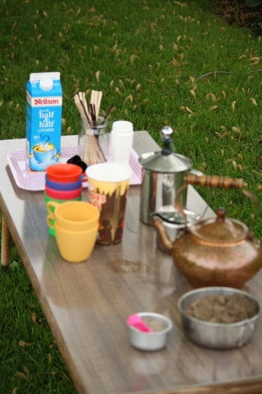 coffee shop pretend play activity table in backyard play space
