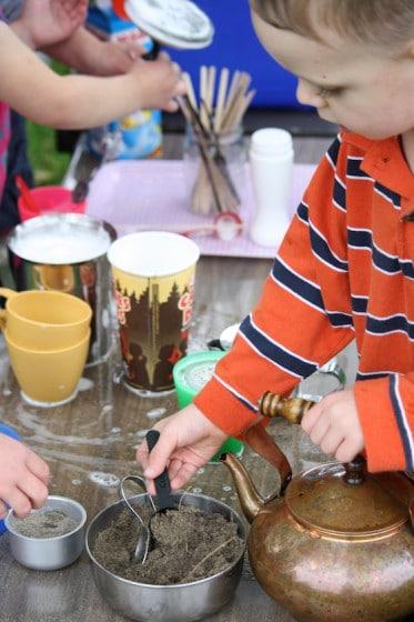 """preschoolers scooping sand """"sugar"""""""