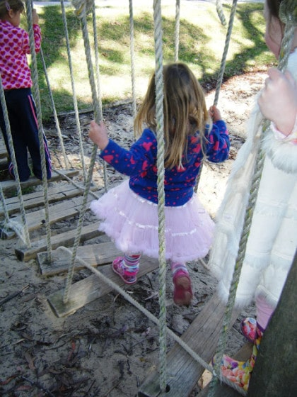toddlers walking on rickety old bridge - balancing activity