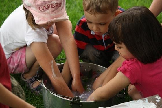 kids washing hands in bucket