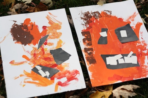 finished pumpkin paintings done by a toddler and preschooler