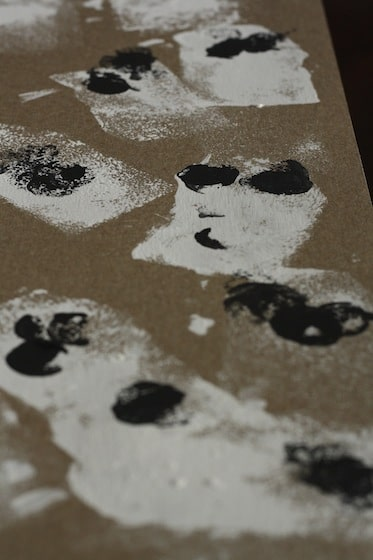 ghosts stamped on cardboard with sponge dipped in white paint