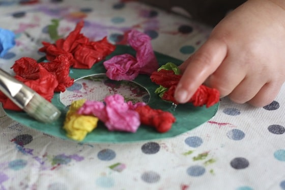 gluing tissue paper to cardboard wreath