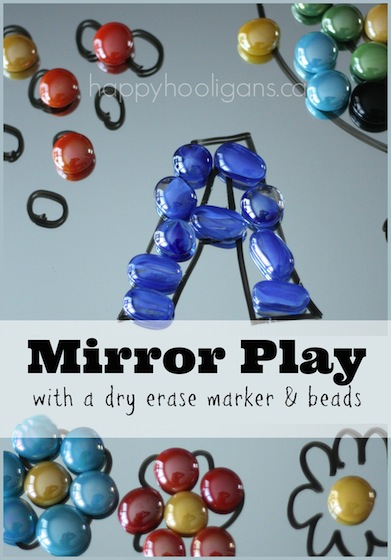 Drawing activity with mirrors and dry erase markers and glass beads