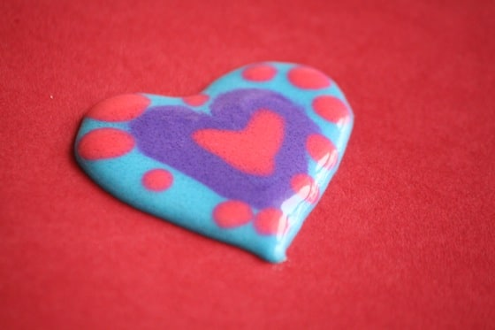 Heart made by layering colours of homemade puffy paint