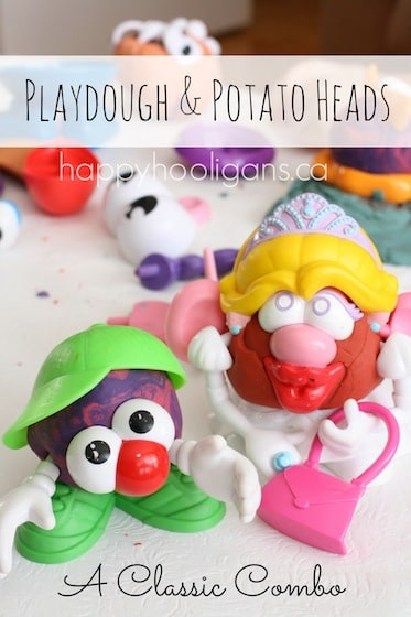 Mrs. Potato Head and son made of homemade play dough and potato head parts.
